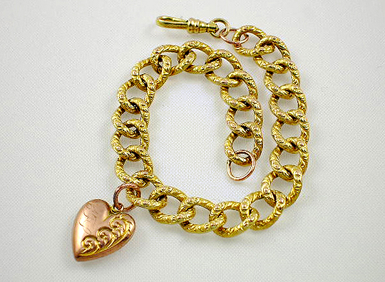 Victorian 10K two-tone pink/yellow gold puffed heart charm bracelet.