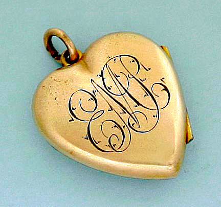 Victorian gold-filled heart locket showing engraved