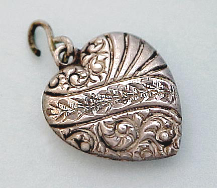 "Victorian engraved puffed heart charm hallmarked ""Sterling""."