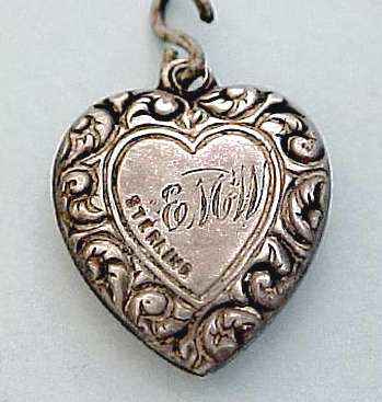 Victorian engraved puffed heart charm.