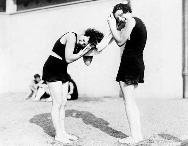 Two women in bathing costumes drying their hair, c.1928.