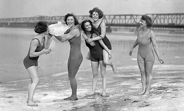 Five women in 1920s swimsuits on icy beach in February 1924.