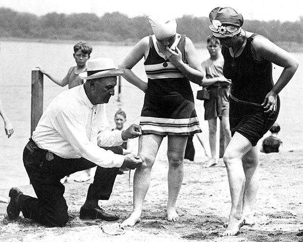 "A 1922 photo shows Bill Norton, the bathing beach ""cop"", using a tape measure to determine the distance between a woman's knee and the bottom of her bathing suit. Remember a similar scene from ""Boardwalk Empire""?"