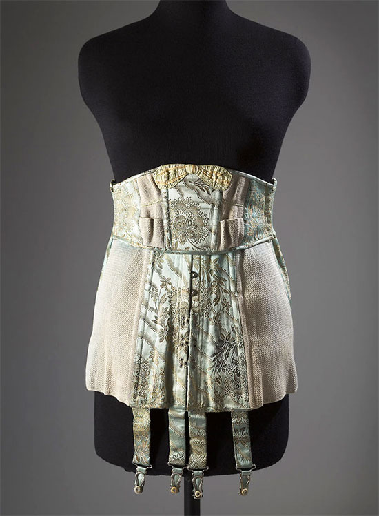 Strouse Adler Company corset, Brocaded satin, elastic, ribbon, circa 1920. [Image credit: Fashion Institute of Technology, www.fitnyc.edu/museum.asp]
