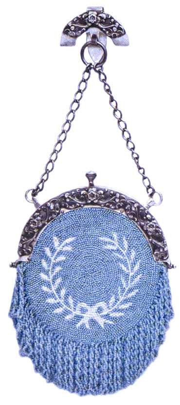 Crocheted Beaded Silk Purse This antique purse design features a wreath of opal beads on a background of blue. This style of chatelaine bag are mounted with silver tops.