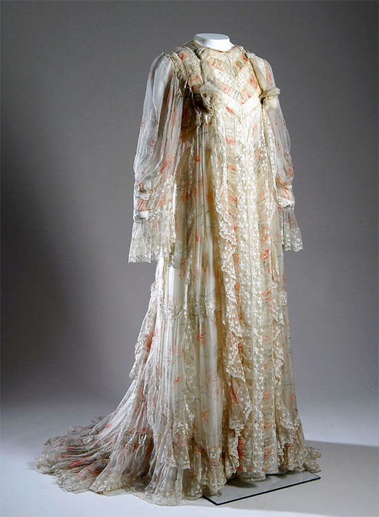 Fernande Burel tea gown, chiffon, silk, and lace, circa 1900, France. The 19th century's social standard for house calls meant that even the most leisurely of women needed to look well-dressed, even when relaxing at home. Garments like this French tea gown from 1900 were included in the lives of aristocrats who needed to be ready to accept visitors at the drop of a hat. [Image credit: Fashion Institute of Technology, www.fitnyc.edu/museum.asp]