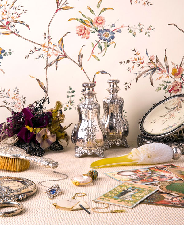 """""""LADIES TOILETTE"""" SCENE """"Ladies Toilette"""" scene including a swan-billed flask retailed by Theodore B. Starr, cases, and engraved glass and silver, 1885-1910. Courtesy of Ingalls Photography, 2012. All objects from the Museum of the City of New York. Photo courtesy of Town & Country"""