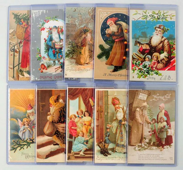Lot of 10 Santa Postcards including three St. Nicholas in white robes, four Santas in brown, and three in pink, red, and blue. Est. $200-300. [Image credit: Morphy Auctions - www.morphyauctions.com]