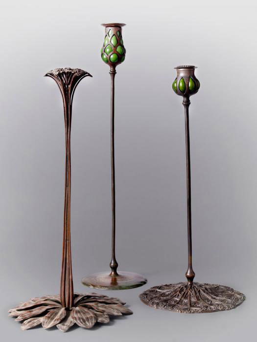 TIFFANY CANDLESTICKS: Group of Tiffany candlesticks. Photo by John Faier; Courtesy of The Richard H. Driehaus Museum