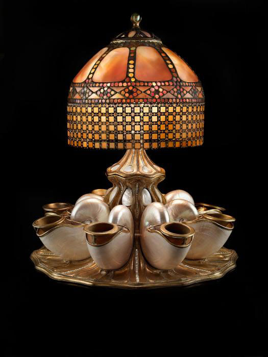 TIFFANY LAMP: Tiffany Studios (American, est. 1902). Nautilus shell centerpiece lamp, ca. 1910. Photo by John Faier; Courtesy of The Richard H. Driehaus Museum