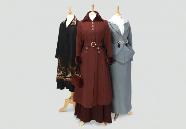 Left: Lady Edith Crawley Black coat edged in autumnal colored Embroidery. Middle: Lady Mary Crawley Burgundy Coat and Hat and Pocket Book. Right: Lady Sybil Crawley Blue/Green Suit and hat. Photo Credit: Exhibits Development Group.