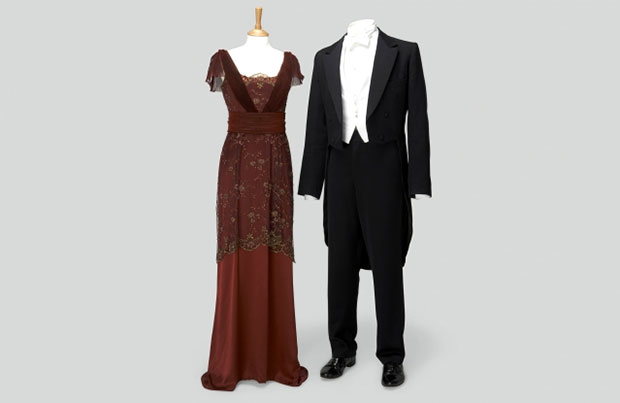 Left: Lady Mary Crawley Dark Red Dress Worn at Dinner the night of the hunt. Right: Matthew Crawley Black Tail Suit with Waistcoat, White Shirt, White Tie Worn at dinner the night of the hunt and for most other formal occasions. Photo Credit: Exhibits Development Group.