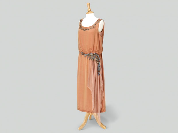 Lady Edith Crawley Peach colored evening dress made up of two layers of silk, the top sheer layer with a gold iridescent quality. Photo Credit: Exhibits Development Group.