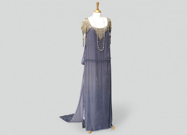 Cora Crawley, Countess of Grantham Gray drop waist silk velvet formal dress with original bodice from the 1920s embellished with diamante stones and gold seed beads. Photo Credit: Exhibits Development Group.