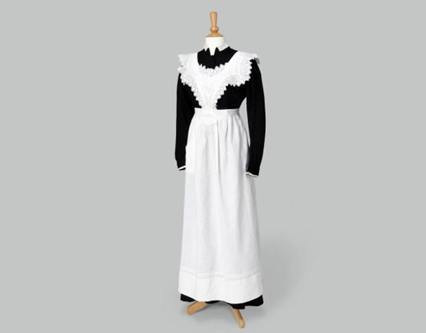 Maids Uniform: Black Dress with White Apron. Photo Credit: Exhibits Development Group.
