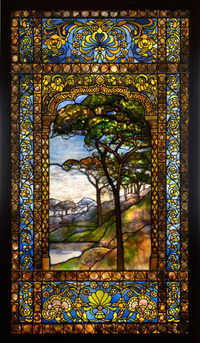 TIFFANY WINDOW: Tiffany Studios (American, est. 1902). Landscape window, 1893-1920. Photo by John Faier; Courtesy of The Richard H. Driehaus Museum