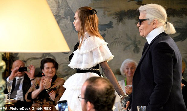 Cara Delevingne, who walked the runway with designer Karl Lagerfeld, wears another Victorian inspired Chanel creation.