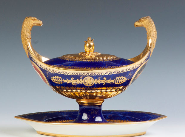 Sevres Cobalt & Gold Enameled Tureen from the 'Service Iconographique Grec'. C. 1812. Sgn. With double eagle heads. Sevres mark and 1812 printed in red; gold script, 2juin BT. Green numerals, 13.cv.12. Provenance: Descended in the family of William Weightman. The tureen was used in his house in Mt. Airy, outside Philadelphia where he entertained lavishly. Estimate: $5000-$8000. [Image credit: Cotton Auctions, Lot #383]